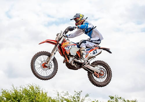 Jack Arnold using off road motorcycle wheels